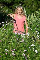 A woman working in her garden near Trout Creek, WA.