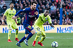 Lionel Andres Messi of FC Barcelona (L) fights for the ball with Amath Ndiaye Diedhiou of Getafe CF (R) during the La Liga 2017-18 match between FC Barcelona and Getafe FC at Camp Nou on 11 February 2018 in Barcelona, Spain. Photo by Vicens Gimenez / Power Sport Images