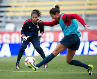 USWNT goalkeeper Adrianna Franch keeps her eye on the shot of teammate Christen Press during practice at Crew Stadium in Columbus, OH.