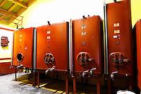 Painted steel red fermentation tanks. Domaine la Tourade, André Andre Richard, Gigondas, Vacqueyras, Vaucluse, Provence, France, Europe