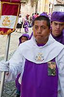 Antigua, Guatemala.  Procession Leader Escorts a Float (Anda) through Antigua's Streets during Holy Week, La Semana Santa.