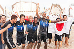 Japan Team's players celebrate after winning the Beach Soccer Men's Team Gold Medal Match between Japan and Oman on Day Nine of the 5th Asian Beach Games 2016 at Bien Dong Park on 02 October 2016, in Danang, Vietnam. Photo by Marcio Machado / Power Sport Images