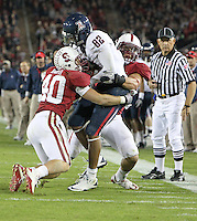 STANFORD, CA - November 6, 2010: Shayne Skov (right) and Taylor Skaufel on a tackle during a 42-17 Stanford win over the University of Arizona, in Stanford, California.