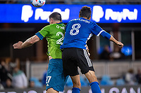 SAN JOSE, CA - MAY 12: Shane O'Neill #27 of the Seattle Sounders and Chris Wondolowski #8 of the San Jose Earthquakes head the ball during a game between San Jose Earthquakes and Seattle Sounders FC at PayPal Park on May 12, 2021 in San Jose, California.