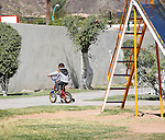 CHILD IN ALGODONES ENJOYS BIKE RIDE ON SUNNY DAY