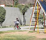 CHILD IN ALGODONES ENJOYS BIKE RIDE ON SUNNY DAY