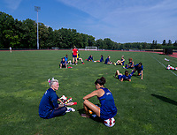 CLEVELAND, OH - SEPTEMBER 14: Jane Campbell and Carli Lloyd of the United States relax after a training session at the training fields on September 14, 2021 in Cleveland, Ohio.