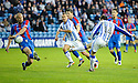 KILMARNOCK'S PAUL HEFFERNAN'S SHOT SEEMS TO HIT THE ARM OF CALEY'S ROSS TOKELY BUT THE REF WAVES PLAY ON.