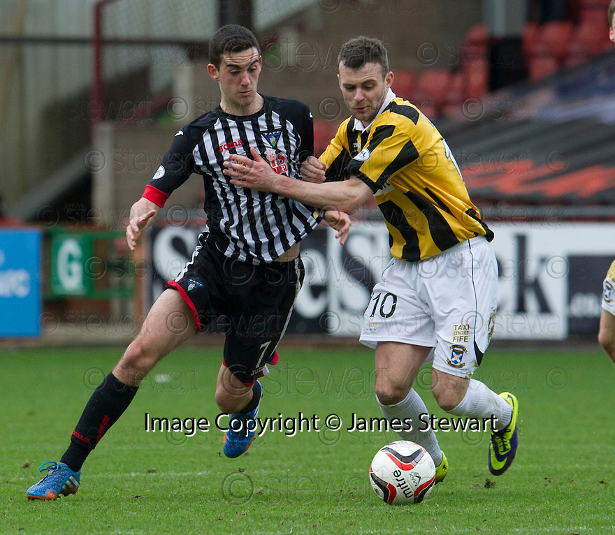 East Fife's Kevin Smith holds off Pars' Shaun Byrne.