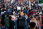 A man dressed in a Trump costume walks through Times Square as people gather in celebration after former Vice President Joe Biden was declared the winner of the 2020 presidential election between U.S. President Donald Trump and Biden on November 7, 2020 in New York City.  Photograph by Michael Nagle