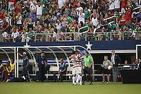 Chris Wondolowski #19 of the USMNT substitutes for Landon Donovan #10 in the second half against Honduras on July 24, 2013 at Dallas Cowboys Stadium in Arlington, TX. USMNT won 3-1.