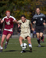 Boston College forward Victoria DiMartino (1) shoots as Florida State midfielder Tori Huster (10) closes. Florida State University defeated Boston College, 1-0, at Newton Soccer Field, Newton, MA on October 31, 2010.