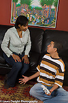 Teenage boy age 15 discussion argument with mother over electronic game use