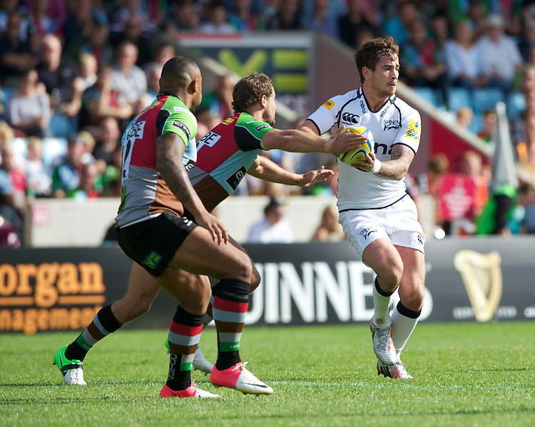 Danny Cipriani of Sale Sharks is tackled by Nick Evans of Harlequins during the Aviva Premiership match between Harlequins and Sale Sharks at The Twickenham Stoop on Saturday 15th September 2012 (Photo by Rob Munro)
