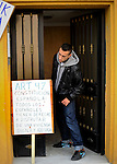 SPAIN, Madrid : Jonathan Torres, grandson of Vicente Torres, leaves the apartment building of his grandfather in Madrid on April 18, 2012. Vicente Torres, 73, who is severy ill and underwent a recent heart surgery, faces an eviction from his house. Eviction procedures in Spanish courts for unpaid mortgages and rent hit a record of 58,241 in 2011, a 21.2 percent rise over the previous year. Evictions have soared in Spain since the collapse of a property bubble in 2008 that triggered the country's economic crisis. Placard reads 'Art 42 of the Spanish Constitution: All Spaniard have the right to live in a decent home'. (c) Pedro ARMESTRE