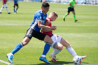 SAN JOSE, CA - APRIL 24: Cristian Espinoza #10 of the San Jose Earthquakes battles for the ball during a game between FC Dallas and San Jose Earthquakes at PayPal Park on April 24, 2021 in San Jose, California.