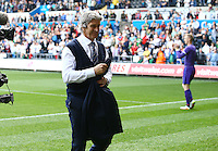 Manchester City manager Manuel Pellegrini gives his suit jacket to a City fan at full time during the Barclays Premier League match between Swansea City and Manchester City played at The Liberty Stadium, Swansea on 15th May 2016