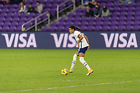 ORLANDO, FL - JANUARY 22: Alana Cook #28 passes the ball during a game between Colombia and USWNT at Exploria stadium on January 22, 2021 in Orlando, Florida.