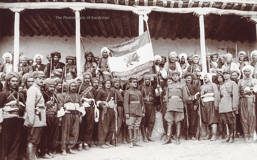 Iran 1930 .3rd from right, Ali Agha, grand-father of Ali Ali and chiefs of Kurdish tribes with the persian flag.<br />