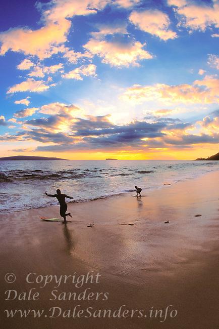 Skim boarding at Big Beach at sunset, Oheloa Beach Park, Maui, Hawaii, USA.
