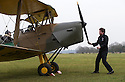 """13/03/15<br /> <br /> Will Flanagan starts the engine by turning the propeller by hand.<br /> <br /> ***FULL STORY HERE:   http://www.fstoppress.com/articles/tiger-moth-restorations/    ****<br /> <br /> You may remember spending hours toiling over Airfix models, painstakingly following intricate instructions and trying not to glue your fingers together before painting your own miniature version of one of the RAF's or Luftwaffe's finest aircraft. Then spare a thought for one man who has just helped to restore and put together one World War Two Tiger Moth and is about to start piecing together another FOUR aircraft that were discovered in bits in a barn.<br /> Sixty-year-old Colin Temple-Smith – who wears a moustache that any Wing Commander would be proud of – has spent a lifetime restoring vintage cars and motorcycles and recently quit his job as a window fitter to help re-build the five bi-planes that will become part of a growing fleet of Tiger Moths at Derbyshire based Blue Eye Aviation.<br /> <br /> Today saw the first of the fully-restored five aircraft take to the skies.<br /> <br /> """"It's just like working on old bikes and cars, although they're a lot more fragile"""" explained Colin, whose wife runs the Aviators Café at Darley Moor Airfield near Ashbourne.<br /> <br /> """"When I was a teenager I used to be a member of a modelling club, making flying models from wood and canvas. They're very similar to build – it's really just the size that's changed with these.<br /> <br /> All Rights Reserved: F Stop Press Ltd. +44(0)1335 418629   www.fstoppress.com."""