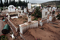 Pictured: Graves at the Mandra Cemetery have been covered with mud and debris.<br /> Re: People have died, some still missing and severe damage caused by heavy rain and flash flooding in the area of Mandra, near Athens, Greece. Thursday 16 November 2017