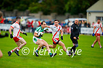 Andrew Barry of Na Gaeil been well marshalled by Fiach O'Loingsigh and Tomás O'Se of An Ghaeltacht in the Intermediate Club Football Championship
