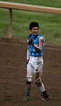 Jockey Miguel Mena lets the people know he is alright after his ride, Libertyrun, and he went down near the finish line of the fourth race at Ellis Park in Henderson, Ky., Sunday afternoon, Aug. 9, 2020. Libertyrun was later euthanized when they'd learned the horse had fractured its leg.