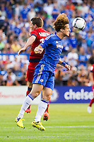 David Luiz (4) of Chelsea FC goes up for a header with Kevin Gameiro (19) of Paris Saint-Germain. Chelsea FC and Paris Saint-Germain played to a 1-1 tie during a 2012 Herbalife World Football Challenge match at Yankee Stadium in New York, NY, on July 22, 2012.