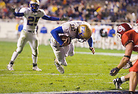 23 December 2006: Tulsa quarterback Paul Smith dives into the endzone for a touchdown during the 2006 Bell Helicopters Armed Forces Bowl between The University of Tulsa and The University of Utah at Amon G. Carter Stadium in Fort Worth, TX.
