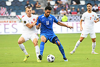 KANSASCITY, KS - JULY 11: Emmanuel Riviere #11 of Martinique holds off Alistair Johnson #2 of Canada during a game between Canada and Martinique at Children's Mercy Park on July 11, 2021 in KansasCity, Kansas.