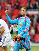 Pictured: Swansea goalkeeper Lukasz Fabianski thanks supporters after the final whistle. Saturday 16 August 2014<br />