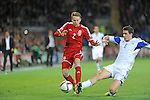 UEFA European Championship at Cardiff City Stadium - Wales v Cyprus : <br /> Chris Gunter of Wales is tackled by Angelis Angelis of Cyprus.