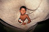 Koatinemo village, Amazon, Brazil. Assurini Indian boy.