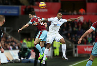Luciano Narsingh of Swansea City is challenged by Robbie Brady of Burnley during the Premier League match between Swansea City and Burnley at The Liberty Stadium, Swansea, Wales, UK. Saturday 06 March 2017