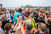 BNPS.co.uk (01202 558833)<br /> Pic: MaxWillcock/BNPS<br /> <br /> Pictured: Crowds gather around Joe Wicks after the run.<br /> <br /> Hundreds of runners responded to an Instagram invitation to join the nation's favourite PE teacher Joe Wicks on an early morning 5km run from Bournemouth Pier to Boscombe Pier and back.<br /> <br /> Avid fans of The Body Coach had to wake up at the crack of dawn to meet Joe Wicks at 7am for the run down the promenade.