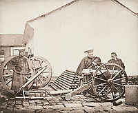 BNPS.co.uk (01202 558833)<br /> Pic: ForumAuctions/BNPS<br /> <br /> Pictured: Men inspect artillery <br /> <br /> Rarely seen 150 year old photos taken by one of the first British photographers to explore China have emerged for sale for £20,000.<br /> <br /> Scotsman John Thomson (1837-1921) travelled to the Far East in 1868 and established a studio in Hong Kong, using it as a base to explore remote parts of the vast country for the next four years, photographing landmarks, scenery and the native population.<br /> <br /> In many cases, he was the first Westerner the people he photographed had encountered.<br /> <br /> One striking image shows a prisoner in chains with a head poking through a board covered in Chinese symbols, perhaps listing his misdemeanours. In another, a man poses next to a giant camel statue in the grounds around the Ming tombs of the Forbidden City.<br /> <br /> Almost 100 of his photos feature in a rare first edition of 'Thomson Illustrations of China and Its People' (1873), which is going under the hammer with London-based Forum Auctions.