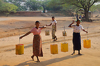 Carrying water in the Traditional Minnanthu Village near Bagan, Myanmar/Burma