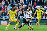 Martin Montoya Torralbo of Valencia CF (R) fights for the ball with Cedric Bakambu of Villarreal CF  (L) during the La Liga 2017-18 match between Valencia CF and Villarreal CF at Estadio de Mestalla on 23 December 2017 in Valencia, Spain. Photo by Maria Jose Segovia Carmona / Power Sport Images