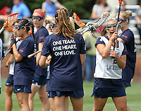 """The University of Virginia women's lacrosse team wore memorial t-shirt that said """"one team, one heart, one love"""" before their first game since the tragic death of teammate Yeardley Love Sunday May 16, 2010 at Klockner Stadium in Charlottesville, Va. The Cavaliers rallied in the last four minutes to beat Towson 14-12 and reach the quarter finals of the NCAA tournament. Love's body was found May 3, and Virginia men's lacrosse player George Huguely is charged with murder. Photo/Andrew Shurtleff.."""