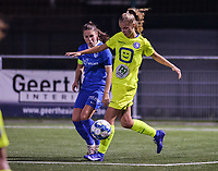 Lore Jacobs (17) of AA Gent and Sien Vandersanden (10) of KRC Genk pictured during a female soccer game between  Racing Genk Ladies and AA Gent Ladies ,  on the 6 th  matchday of the 2021-2022 season of the Belgian Scooore Womens Super League , friday 8 october 2021  in Genk , Belgium . PHOTO SPORTPIX | JILL DELSAUX