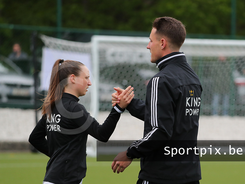 Head coach Jimmy Coenraets of OHL gives a high five to Estee Cattoor (11) of OHL before a female soccer game between Oud Heverlee Leuven and AA Gent Ladies on the 9 th matchday of play off 1 in the 2020 - 2021 season of Belgian Womens Super League , saturday 22 nd of May 2021  in Heverlee , Belgium . PHOTO SPORTPIX.BE   SPP   SEVIL OKTEM