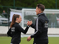 Head coach Jimmy Coenraets of OHL gives a high five to Estee Cattoor (11) of OHL before a female soccer game between Oud Heverlee Leuven and AA Gent Ladies on the 9 th matchday of play off 1 in the 2020 - 2021 season of Belgian Womens Super League , saturday 22 nd of May 2021  in Heverlee , Belgium . PHOTO SPORTPIX.BE | SPP | SEVIL OKTEM