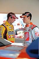 Feb 07, 2009; Daytona Beach, FL, USA; NASCAR Sprint Cup Series driver Joey Logano (right) talks with teammate Kyle Busch during practice for the Daytona 500 at Daytona International Speedway. Mandatory Credit: Mark J. Rebilas-