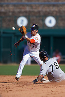 Glendale Desert Dogs shortstop Chan Jong Moon (39) waits for a throw as Gary Sanchez (78) slides in during an Arizona Fall League game against the Surprise Saguaros on October 24, 2015 at Camelback Ranch in Glendale, Arizona.  Surprise defeated Glendale 18-3.  (Mike Janes/Four Seam Images)