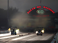 Sep 2, 2017; Clermont, IN, USA; NHRA top fuel driver XXXX (left) races alongside Doug Kalitta during qualifying for the US Nationals at Lucas Oil Raceway. Mandatory Credit: Mark J. Rebilas-USA TODAY Sports