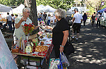 Organizer Linda Marrone, left, talks with Carson City resident Lois Rometsch at the 3rd & Curry St. Farmers Market in downtown Carson City, Nev. on Sept. 11, 2010..Photo by Cathleen Allison/NevadaPhotoSource.com