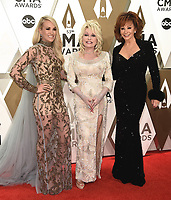 NASHVILLE, TN - NOVEMBER 13: Carrie Underwood, Dolly Parton and Reba McEntire at the 53rd Annual CMA Awards at the Bridgestone Arena on November 13, 2019 in Nashville, Tennessee. (Photo by Scott Kirkland/PictureGroup)