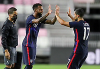FORT LAUDERDALE, FL - DECEMBER 09: Kellyn Acosta #10 and team mate Sebastian Lletget #17 of the United States entering & exiting during a game between El Salvador and USMNT at Inter Miami CF Stadium on December 09, 2020 in Fort Lauderdale, Florida.