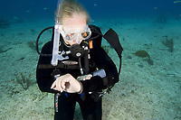 Scuba diver checking dive computer.